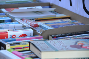 books in boxes on a table